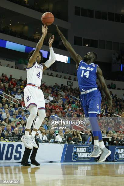 Devonte' Graham of the Kansas Jayhawks shoots a jump shot against Ismael Sanogo of the Seton Hall Pirates in the first half during the second round...