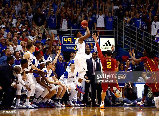 Devonte' Graham of the Kansas Jayhawks shoots a threepointer during the 2nd half of the game against the Iowa State Cyclones at Allen Fieldhouse on...