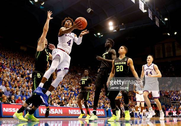 Devonte' Graham of the Kansas Jayhawks shoots during the game against the Baylor Bears at Allen Fieldhouse on January 20 2018 in Lawrence Kansas