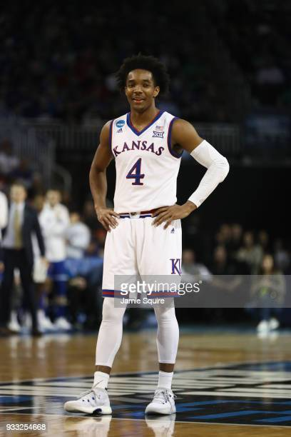Devonte' Graham of the Kansas Jayhawks smiles as they take on the Seton Hall Pirates in the second half during the second round of the 2018 NCAA...