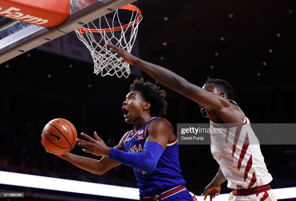 Devonte' Graham #4 of the Kansas Jayhawks takes a shot as Cameron Lard #2 of the Iowa State Cyclones blocks in the second half of play at Hilton Coliseum on February 13, 2018 in Ames, Iowa. The Kansas Jayhawks won 83-77 over the Iowa State Cyclones.
