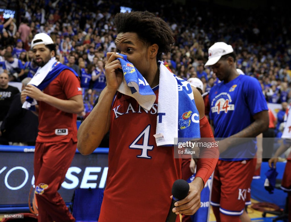 Devonte' Graham #4 of the Kansas Jayhawks wipes his face as he walks of the court after playing his final game at Allen Fieldhouse on February 26, 2018 in Lawrence, Kansas. Kansas Jayhawks bet the Texas Longhorns 80-70 and clinched their 14th consecutive Big 12 Conference Title.