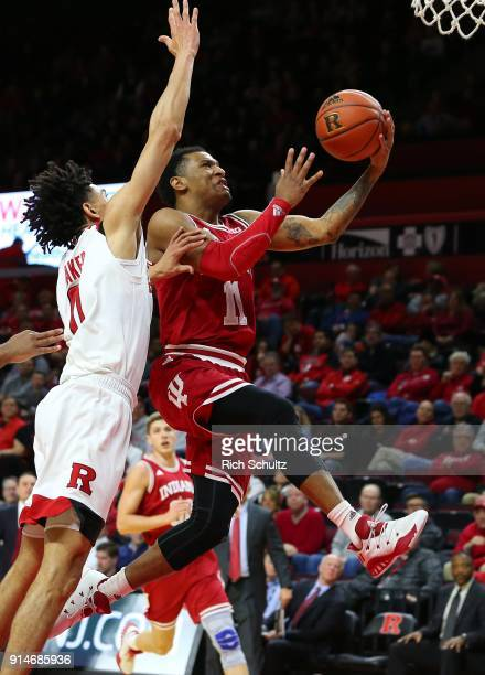 Devonte Green of the Indiana Hoosiers goes up for a shot as Geo Baker of the Rutgers Scarlet Knights defends during the second half of a game at...
