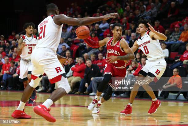 Devonte Green of the Indiana Hoosiers in action against Mamadou Doucoure and Geo Baker of the Rutgers Scarlet Knights during a game at Rutgers...