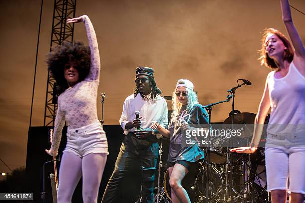 Devonte Hynes and Samantha Urbani perform on stage at FYF Festival at LA Sports Arena on August 24 2014 in Los Angeles United States