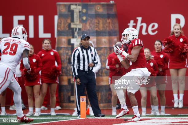 Devonte Williams of the Indiana Hoosiers makes a 23yard touchdown catch in the first quarter of a game against the Wisconsin Badgers at Memorial...