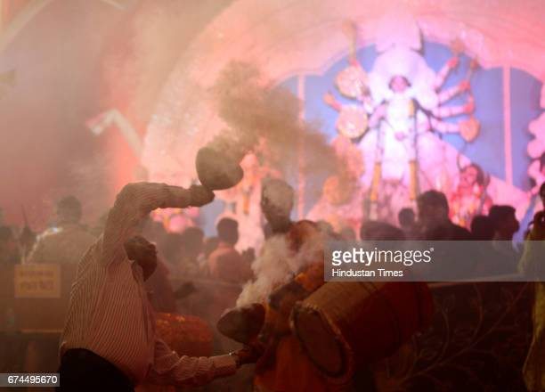 Devote performed Dhunuchi dance during Durga Pooja at shivajipark in Mumbai India