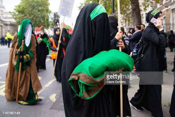 Devote Shia Muslim women wearing traditional black chadors commemorate the festival of Ashura in Whitehall London United Kingdom on 10th Spetember...