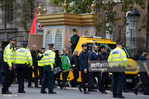 Devote Shia Muslims commemorate the festival of Ashura in Whitehall London United Kingdom on 10th Spetember 2019 It marks the day that Husayn ibn Ali...