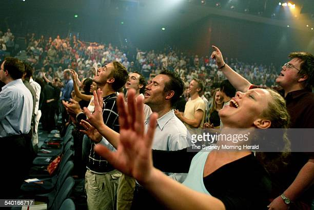 Devoted Christians celebrating Easter Sunday at the Hillsong Church at Baulkham Hills in Sydney 11 April 2004 SMH Picture by BEN RUSHTON