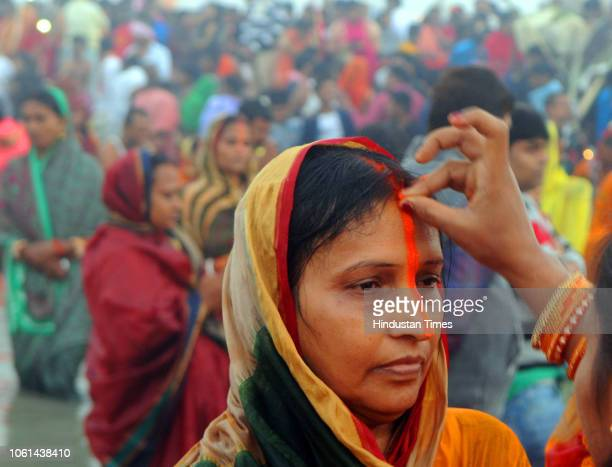 A devotee applies tilak to another as they perform rituals of Chatth Mahaparva festival at river Ganga on November 14 2018 in Patna India Thousands...