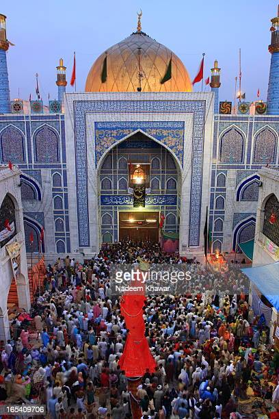 CONTENT] Devotee are entering in to the tomb at the eve of Lal Shahbaz Qalandar's UrsThey bring the red sheets of cotton as red was his favorite...