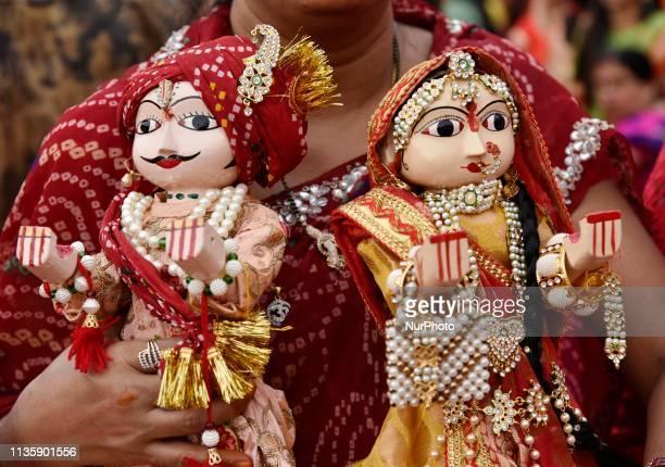 Devotee carry Gangour idol in the occasion of Gangour Teej festival in Guwahati Assam India on April 8 2019 Gangaur Puja or Gangaur Teej is the...