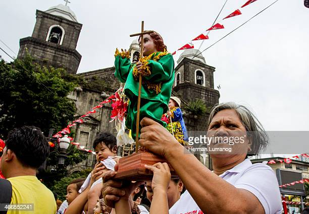 Devotee carrying image of Child Jesus Lakbayaw festival, Lakbayaw from the Tagalog words, Lakbay and Sayaw in the urban area of Tondo, Manila that...