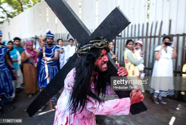 Devotee dressed as Jesus Christ re enacts the Crucifixion during 'Good Friday' procession at Bhandup, on April 19, 2019 in Mumbai, India. Good Friday...