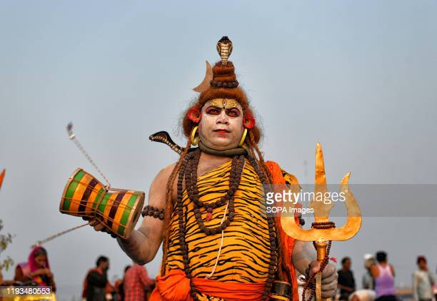 A devotee dressed up like Lord Shiva as per Hindu mythology seen during the Gangasagar Festival to earn some offerings from the pilgrims Gangasagar...