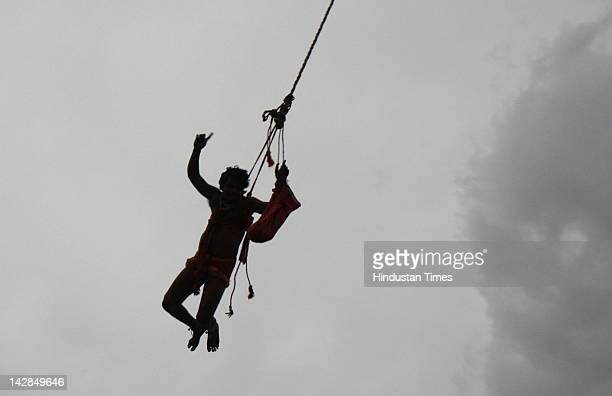 A devotee hanging from a pole during the traditional Chadak Festival on the eve of Bengali new year's day on April 13 2012 in Kolkata India The...