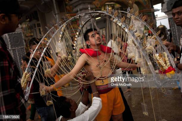 Devotee has his body pierced with hooks before taking part in the Thaipusam procession at Sri Srinivasa Perumal Temple on February 7, 2012 in...