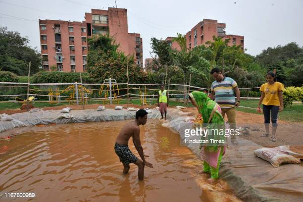 Devotee immerses an idol of Lord Ganesh at a temporary pond on the last day of the Ganesh Chaturthi festival at a park, at Kalkaji on September 12,...