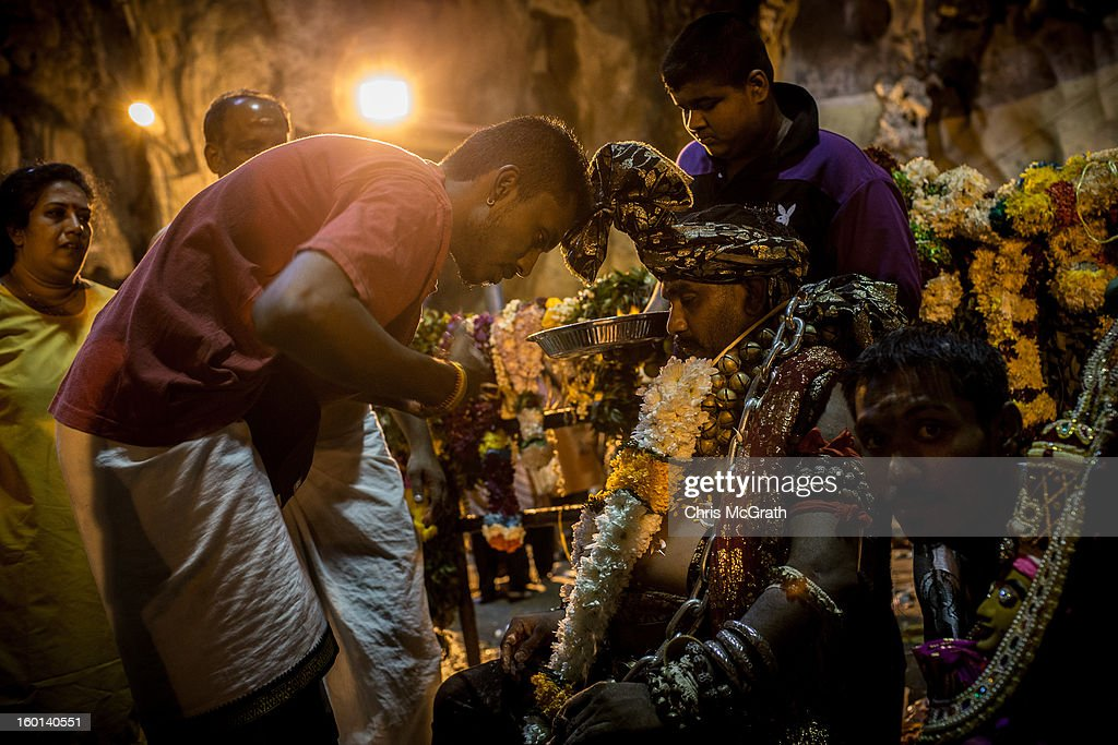 A devotee is assisted after finishing his Thaipusam procession in the Batu Caves on January 27, 2013 in Batu Caves, Malaysia. Thaipusam is a Hindu festival celebrated on the full moon in the Tamil month of Thai. The festival marks the birthday of Lord Muruga and also commemorates the day Hindu Goddess Parvati gave her son a lance to defeat the evil demon Soorapadamwhen. The festival sees devotees carry milk pots to seek forgivness and some will carry a 'Kavadi' many of which are attached via, strings, hooks, and skews pierced into the carriers skin.