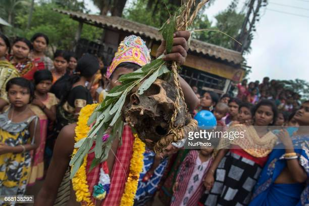 A devotee is holding a human head in his hand in Burdwan India on 13 April 2017 quotGajanquot is one of the prominent folk festivals of Bengal is...