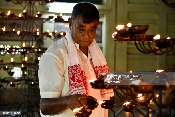 A Devotee lighting clay lamp at a Namghar in the occasion of the 570th Birth Anniversary of Saint Srimanta Sankardeva in Guwahati on Wednesday 19...