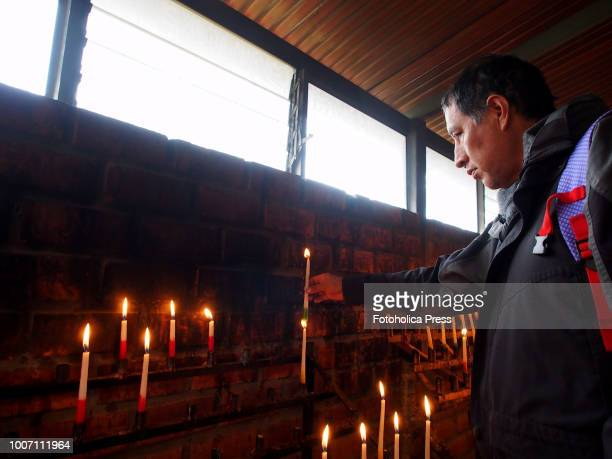 SAPALLANGA HUANCAYO JUNIN PERU A devotee lights a candle for the virgin of Cocharcas in the church of Sapallanga in Huancayo city at the Peruvian...