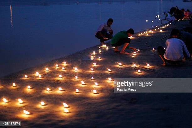 Devotee lit oil lamps at Baluwaghat at the bank of River Yamuna on the occasion of 'Ekadashi festival' in Allahabad