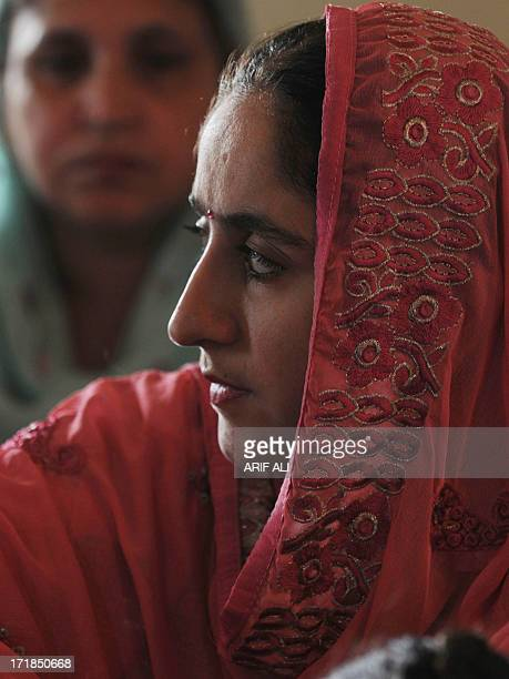A devotee looks on at a Sikh shrine in Lahore on June 29 on the 174th death anniversary of Maharaja Ranjit Singh Singh was also known as...
