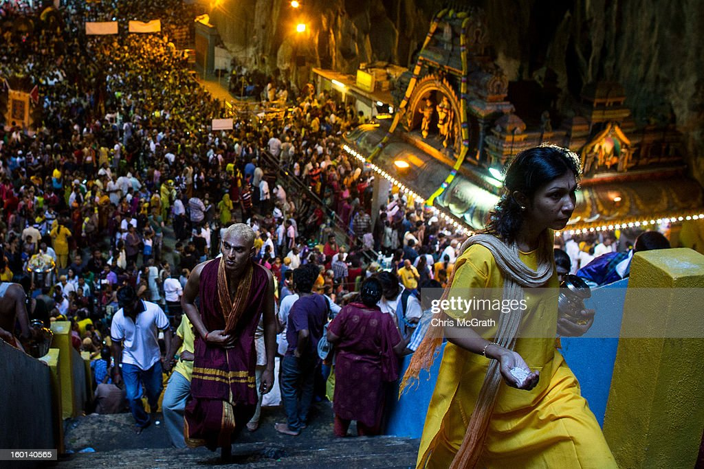 A devotee make offerings inside the Batu Caves during the Thaipusam procession on January 27, 2013 in Batu Caves, Malaysia. Thaipusam is a Hindu festival celebrated on the full moon in the Tamil month of Thai. The festival marks the birthday of Lord Muruga and also commemorates the day Hindu Goddess Parvati gave her son a lance to defeat the evil demon Soorapadamwhen. The festival sees devotees carry milk pots to seek forgivness and some will carry a 'Kavadi' many of which are attached via, strings, hooks, and skews pierced into the carriers skin.