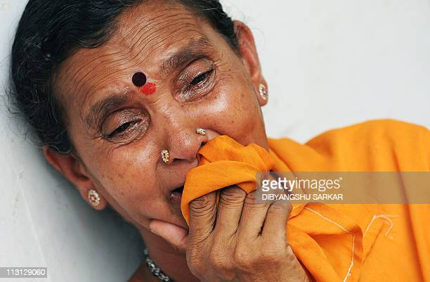 A devotee of Satya Sai Baba burst into tears after his death was announced in the village of Puttaparthi some 200kms north of Bangalore on April 24...