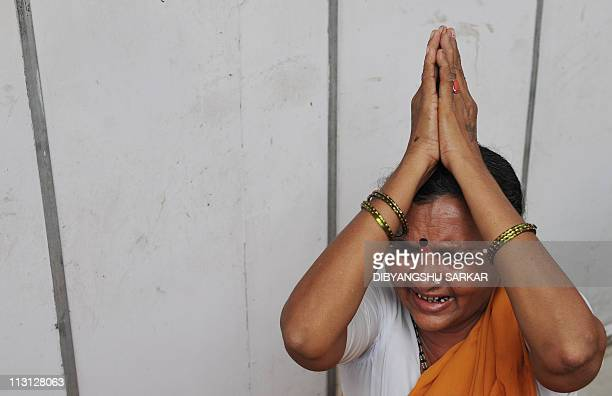 A devotee of Satya Sai Baba bursts into tears after his death was announced in the village of Puttaparthi some 200kms north of Bangalore on April 24...