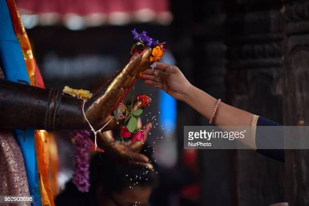 A Devotee offering ritual towards Dipankar Buddha during celebration of Buddha Purnima festival Birth Anniversary of Lord Gautam Buddha at Chiloncho...