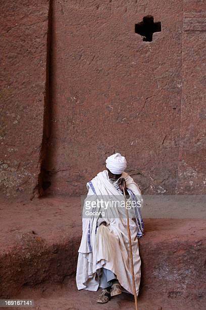 Devotee outside Bet Medhane Alem church in Lalibela