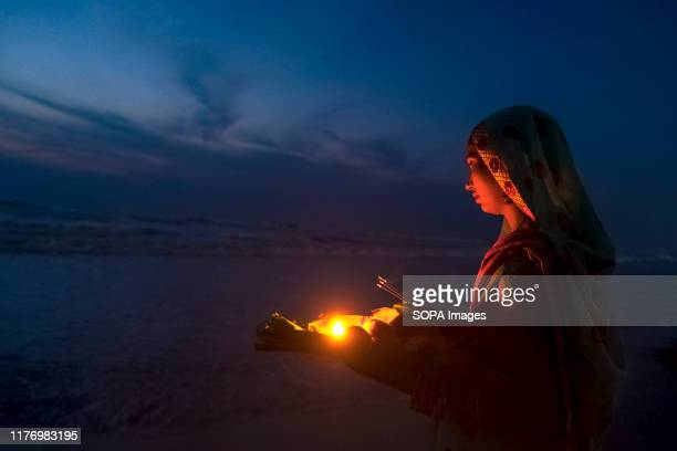 A devotee performs rituals at Marina beach during the festival Chhath Puja is one of the vibrant and colorful festivals of India Mainly Bihari...