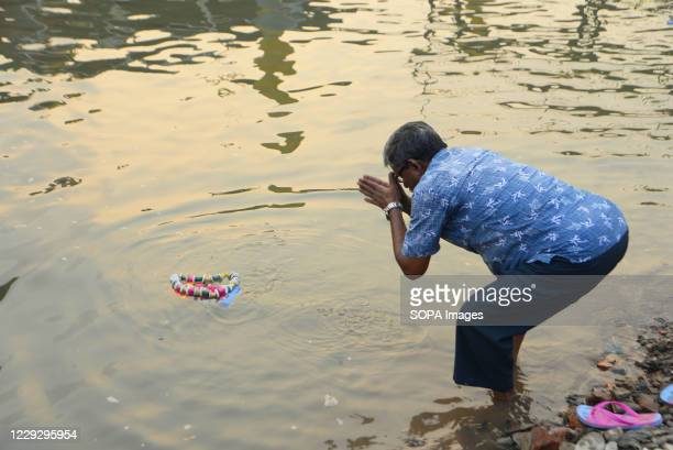Devotee performs rituals during the final day of the Durga Puja festival. Health officials have warned about the potential for the coronavirus to...