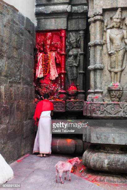 A devotee playing at Kamakhya Temple