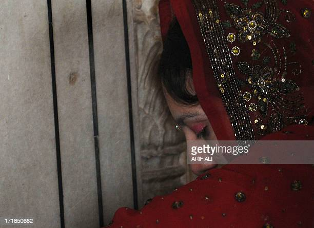 A devotee prays at a Sikh shrine in Lahore on June 29 on the 174th death anniversary of Maharaja Ranjit Singh Singh was also known as 'SherePunjab'...