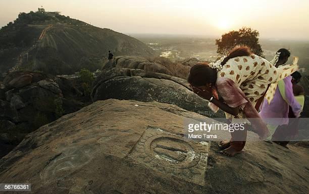 A devotee prays at sunset during preparations for the Mahamastak Abhisheka ceremony February 7 2005 in Shravanabelagola India The Mahamastak...