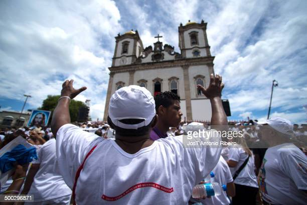 Devotee prays during the feast of the washing steps of Bonfim Church.