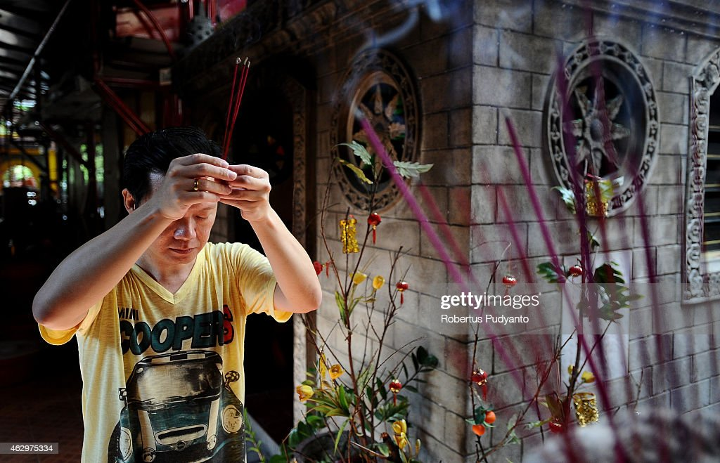 A devotee prays holding incense sticks during Cie Suak rituals at Hong San Ko Tee Temple on February 8, 2015 in Surabaya, Indonesia. Cie suak is a prelude to the Chinese New Year celebrations and this year welcomes the Year of the Goat, with new year's day falling on February 19th. Devotees believe the ritual wards off disease and disasters and also brings health and prosperity.