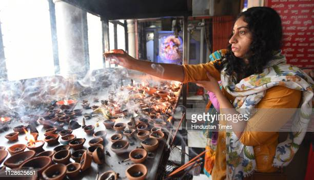 A devotee prays on the occasion of Mahashivratri festival at Old Hanuman temple Baba Kharak Singh Park Connaught Place on March 4 2019 in New Delhi...