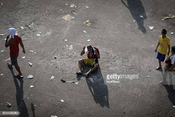 A devotee sits on the road after taking part in the procession of the Black Nazarene in Manila Philippines January 9 2014 The Black Nazarene is a...