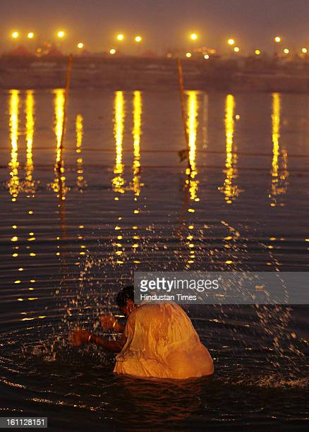 Devotee taking holy dip in Sangam waters in Kumbh mela area on February 9, 2013 in Allahabad, India. The mega religious fair is held once in 12 years...