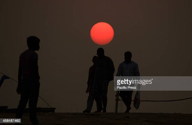Devotee walk at bank of Sangam during Sunset in Allahabad
