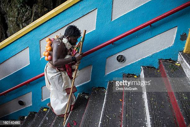 Devotee walks up the 272 steps to the entrance of the Batu Caves during the Thaipusam procession on January 27, 2013 in Batu Caves, Malaysia....