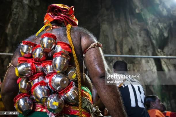 devotee with pierced body as act of devotion. tamil community celebrates hindu festival thaipusam - shaifulzamri stock pictures, royalty-free photos & images