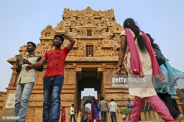 Devotees and other visitors walk near an entrance to the Brihadeshwara Temple in Thanjavur Tamil Nadu India on Sunday Oct 16 2016 India's new central...