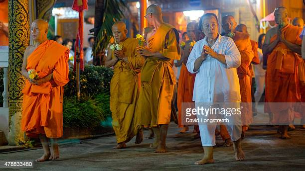Devotees and the faithful gather at Wat Sung Men on Vesakha Day Buddhist in Thailand gather on this date to commemorate the birth enlightenment and...