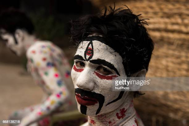 Devotees are performing in a procession dressed up as cosmetic deities in Burdwan India on 13 April 2017 quotGajanquot is one of the prominent folk...